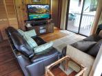 Entertainment area features large flatscreen TV, cable, wifi, bluetooth music bar and plenty of DVDs