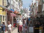 Busy main street in Alvor centre, with shops, restaurants and bars.