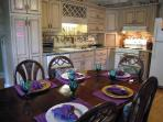 Large Kitchen with Emeril cookware and many appliances. Seating for 10.