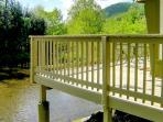 Deck overhangs the river