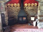 The log burner will keep you warm on cold nights.