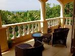 Enjoy the lovely view and ocean breeze on the comfortable balcony.