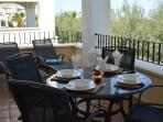 Dining table on the terrace overlooking the golf course.