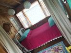Double bed in the sleeping porch nook