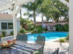 Backyard w/Pool Outdoor seating, firepit and natural gas grill