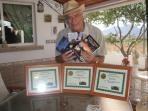 Percy with his writing awards