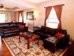 comfy reclining sofa, sofa and ottoman, foosball coffee table, TV with DISH