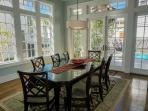 Dining Room with French Doors leading out to private heated pool, patio and deck
