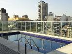 Your dream apartment with a roof top pool and a city view!