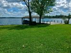 spacious lakefront with an oversized dock and small beach-head.