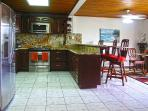Spacious and fully equipped Kitchen with breakfast bar