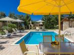 Pool with sunloungers and umbrellas