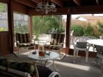 Back screened porch is excellent for enjoying morning coffee, evening libations, fire pit!