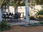 Shaded patio area for alfresco dining.
