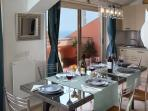 Dining area with  with stunning views on the historic city center of Taormina and the Mediterranean