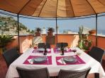 The terrace offers stunning views on the historic city center of Taormina and the Mediterranean