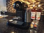 Nespresso machine for coffee lovers. There is also a french press, if that's more your style.