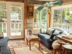 Spacious living room, overlooking the Seldovia estuary and mountain vistas.