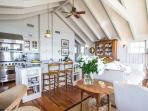Open Living, Kitchen and Dining Area with Vaulted Beamed Ceiiings