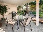 private, covered outdoor patio with gas bbq has a  view of the garden