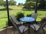 Small outdoor patio area and fenced garden