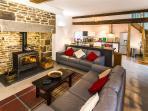 La Belle Grange open plan living kitchen area showing the wood burner