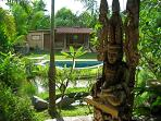 Villa:  Looking past the Bodhisattva to the Mermaid Pavilion in the lower garden.