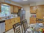 Our bright, roomy kitchen is fully equipped with dining for six