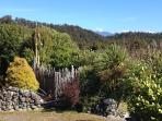 The back garden of the cottage, alps in the distance