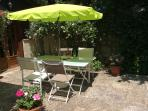 Sunny courtyard outside sitting room - access via double french doors.