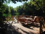 The lake terrace at the Kozia Górka Villa. Enjoy your dining time! Nature oasis near Leba at Baltic.
