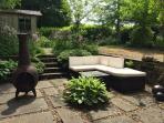sunken patio at rear of main garden providing seating area