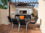 barbecue and dining area on the swimming pool