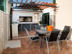 bbq and dining chairs and table