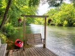 You'll love spending time down on the private deck located right on the river!