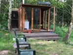 Private pod off grid with solar panel on roof to power LED light