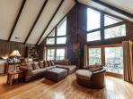 Living Room with beautiful mountain views and spectacular wood burning fireplace