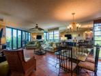 Living dining area are flooded with natural sunlight and an ocean view