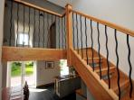Beautiful oak stair leads to upstairs landing.