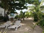 Beautiful, shady side yard with beach view.