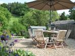 The patio terrace with wonderful countryside views - a perfect BBQ spot.