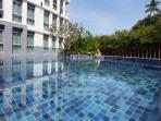 swimming pool with sundbeds