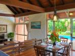 Large dining area with direct outdoor and pool access