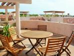 Roof Top Terrace with chairs, table and lounge charis. Amazing Views of the Caribe Blue Ocean