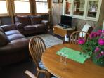 enclosed porch with comfy leather couches with Cable TV and WiFi