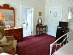 Newly renovated and furnished with antique furniture this room is sunny and bright! Perfect for two.
