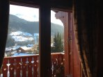 Lounge double doors leading to balcony & uninterrupted views south to Les Allues village & Meribel