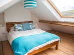 Main double bedroom in the attic with views out to sea and the countryside.