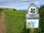 Step through the gate onto the coastal path and you're on Bembridge Down owned by The National Trust