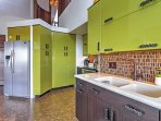 Green cabinets add a splash of color!